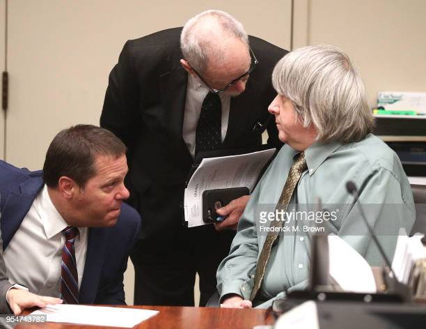 Public Defender Jeff Zimel Attorney David Macher and David Allen Turpin speak before a court hearing on May 4 2018 in Riverside California According...