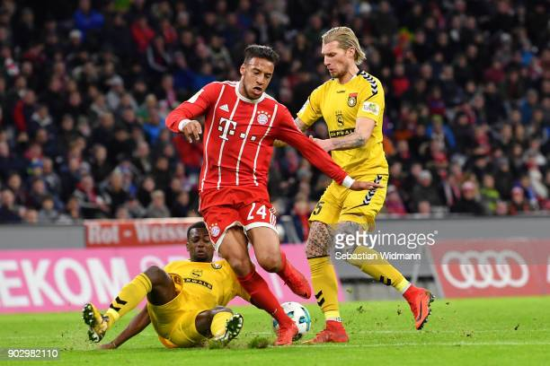 JeffDennis Fehr and Kai Gehring of Sonnenhof Grossaspach challenge Corentin Tolisso of Bayern Muenchen for the ball during the friendly match between...