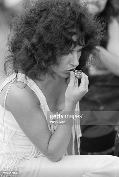 Jefferson Airplane singer Grace Slick inhales marijuana through a pipe at the free Woodstock Music and Art Fair The festival took place on Max...