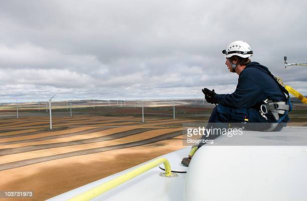 Jefferson Barbee sits on the nacelle of an Acciona wind turbine at the NaturEner USA LLC Glacier wind energy farm in Ethridge Montana US on Monday...