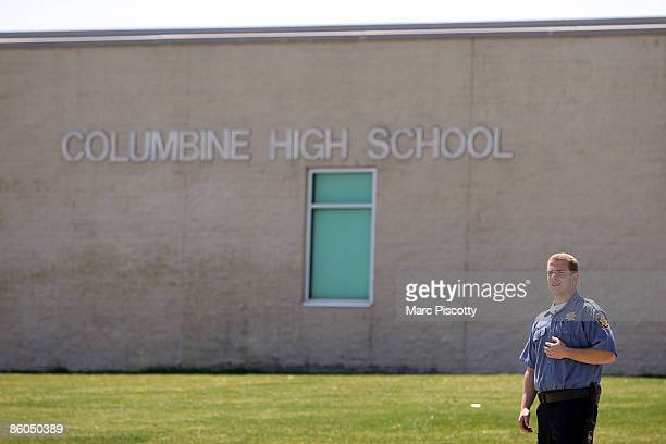 Jefferson County Schools security officer stands guard at the entrance to Columbine High School on the tenyear anniversary of the Columbine High...