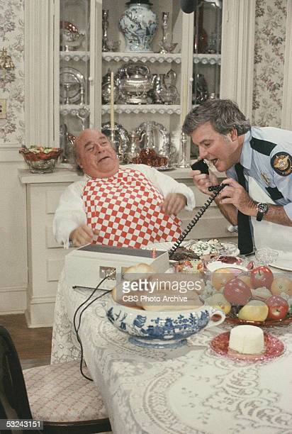 Jefferson Davis 'Boss' Hogg played by American actor Sorrell Booke sits back and laughs with a gingham napkin tucked into his shirt as Sheriff Roscoe...