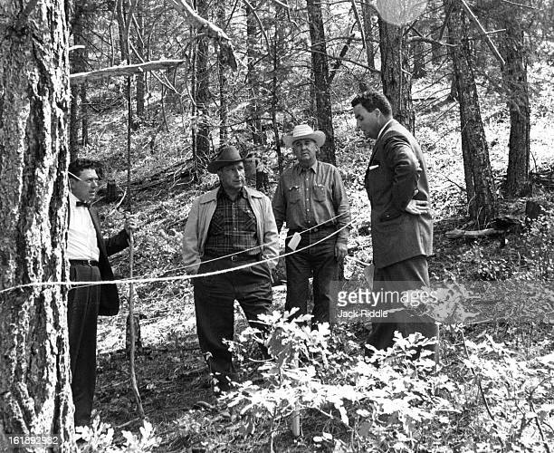 SEP 24 1960 Jefferson Douglas County Officials Review Coors Data Law officials of Jefferson and Douglas counties inspect area in forest near Sedalia...