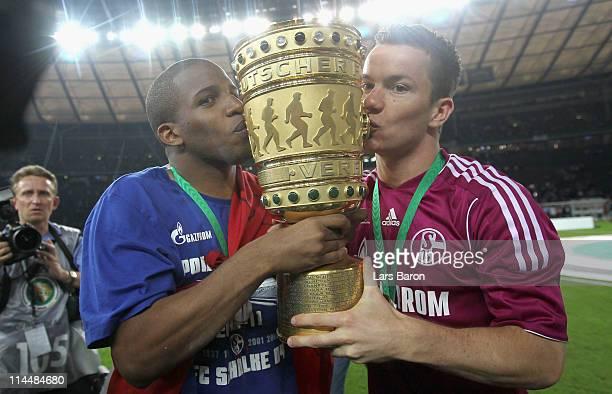 Jefferson Farfan and Alexander Baumjohann of Schalke celebrate after the DFB Cup final match between MSV Duisburg and FC Schalke 04 at Olympic...