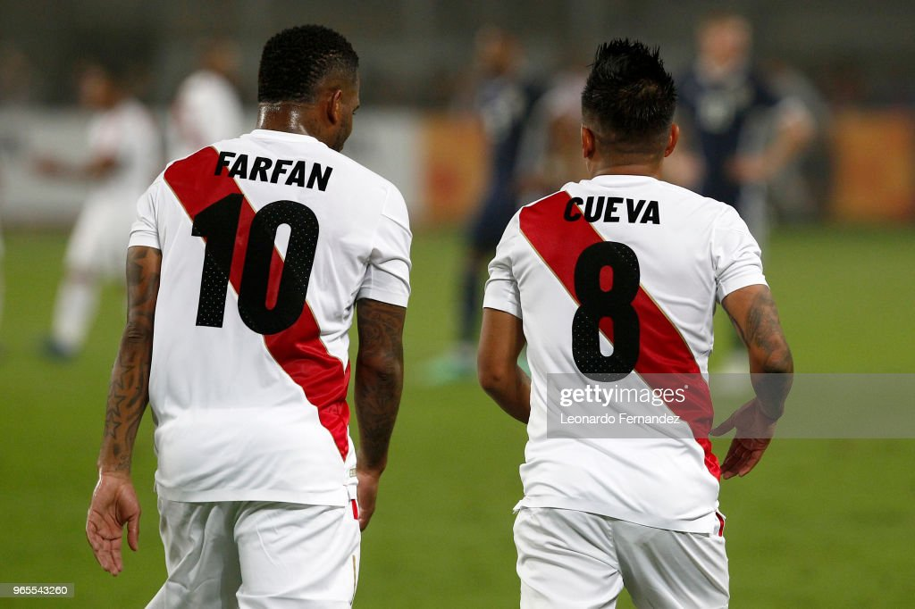 Jefferson Farfan and Christian Cueva of Peru look on during the international friendly match between Peru and Scotland at Estadio Nacional de Lima on May 29, 2018 in Lima, Peru.
