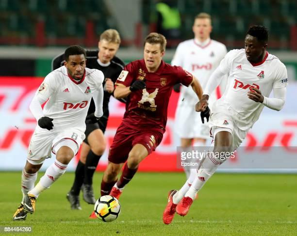 Jefferson Farfan and Eder of FC Lokomotiv Moscow vies for the ball with Maksim Kanunnikov of FC Rubin Kazan during the Russian Premier League match...