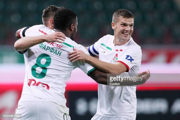 Jefferson Farfan and Igor Denisov of FC Lokomotiv Moscow celebrate a goal during the Russian Football League match between FC Lokomotiv Moscow and FC...