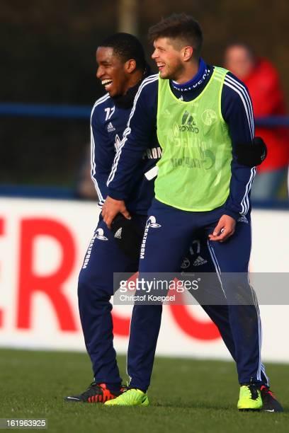 Jefferson Farfan and KlaasJan Huntelaar make nonsense during the FC Schalke 04 training session at their training ground on February 18 2013 in...