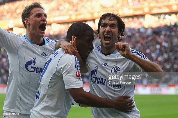 Jefferson Farfan celebrates the first goal with Benedikt Hoewedes and Raul Gonzalez of Schalke during the Bundesliga match between Bayer 04...