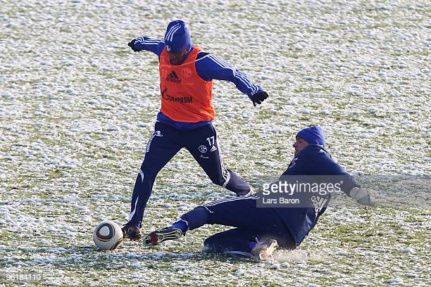 Jefferson Farfan is challenged by goalkeeper Mathias Schober during a Schalke 04 training session on January 26, 2010 in Gelsenkirchen, Germany.