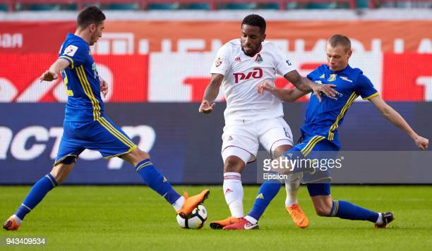 Jefferson Farfan of FC Lokomotiv Moscow vie for the ball with Aleksei Ionov and Yevgeni Makeyev of FC Rostov RostovonDon during the Russian Football...