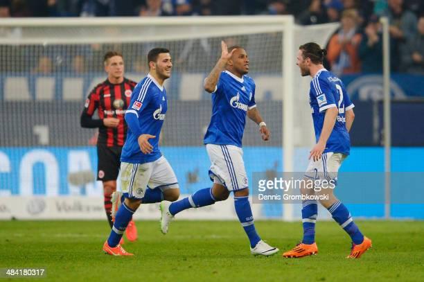 Jefferson Farfan of FC Schalke 04 celebrates with team mates after scoring his team's second goal during the Bundesliga match between FC Schalke 04...