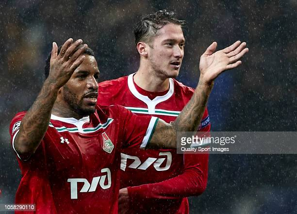 Jefferson Farfan of Lokomotiv celebrates after scoring his sides first goal with his teammate Anton Miranchuk during the Group D match of the UEFA...