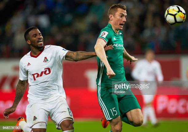 Jefferson Farfan of Lokomotiv Moscow vies for the ball with Andrei Semyonov of FC Akhmat Grozny during the Russian Premier League match between FC...