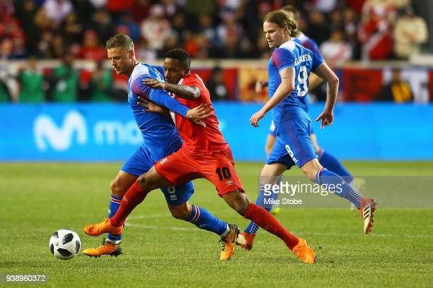 Jefferson Farfan of Peru and Ragnar Sigurdsson of Iceland vie for the ball during an International Friendly at Red Bull Arena on March 27 2018 in...