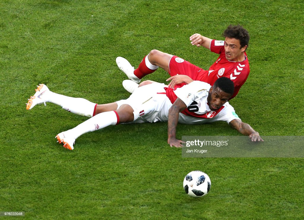 Jefferson Farfan of Peru and Thomas Delaney of Denmark fall down during the 2018 FIFA World Cup Russia group C match between Peru and Denmark at Mordovia Arena on June 16, 2018 in Saransk, Russia.
