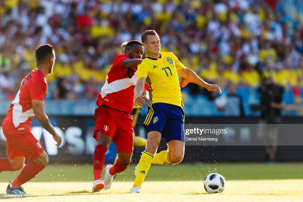 Jefferson Farfan #10 of Peru and Viktor Claesson #17 of Sweden battle for the ball, during the international friendly match between Sweden v Peru at the Ullevi Stadium on June 9, 2018 in Gothenburg, Sweden.