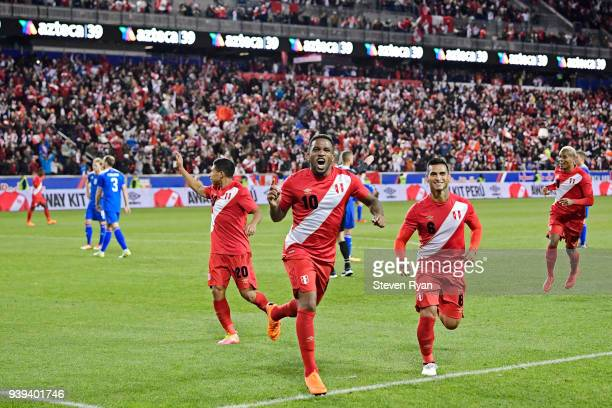 Jefferson Farfan of Peru celebrates his second half goal with his teammates against Iceland in an International Friendly match at Red Bull Arena on...