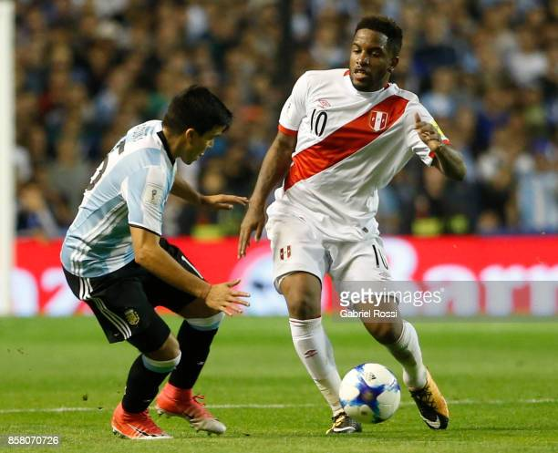 Jefferson Farfan of Peru fights for the ball with Marcos Acuña of Argentina during a match between Argentina and Peru as part of FIFA 2018 World Cup...