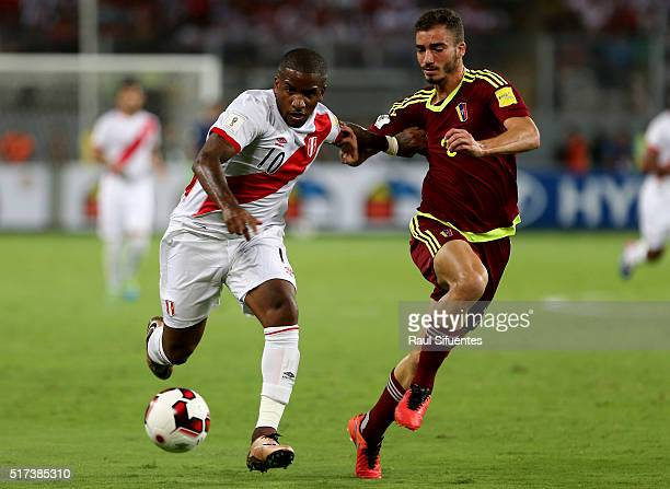 Jefferson Farfan of Peru struggles for the ball with Mikel Villanueva of Venezuela during a match between Peru and Venezuela as part of FIFA 2018...