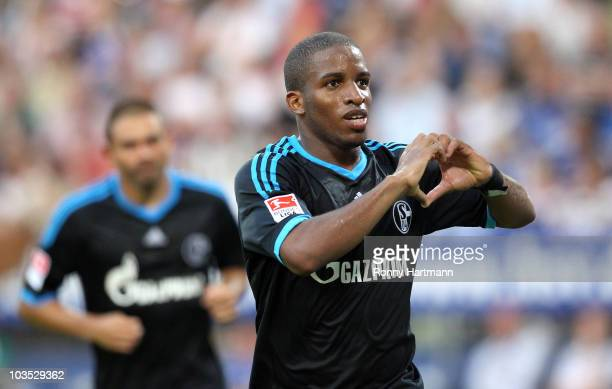 Jefferson Farfan of Schalke 04 celebrates after scoring his team's first goal during the Bundesliga match between Hamburger SV and FC Schalke 04 at...