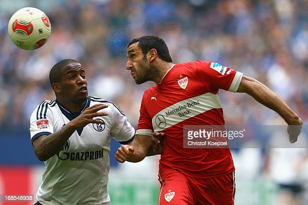 Jefferson Farfan of Schalke and Christian Molinaro of Stuttgart go up for a head during the Bundesliga match between FC Schalke 04 and VfB Stuttgart...