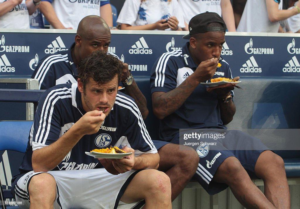 Jefferson Farfan of Schalke (R) and Tranquillo Barnetta eat spanish food after Raul's farewell match between Schalke 04 and Al-Sadd Sports Club Katar at Veltins Arena on July 27, 2013 in Gelsenkirchen, Germany.