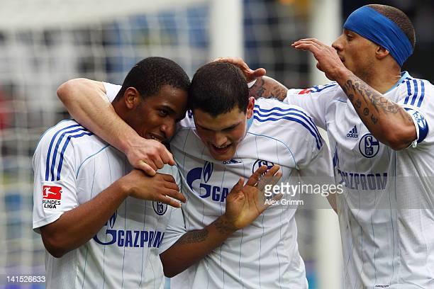 Jefferson Farfan of Schalke celebrates his team's fourth goal with team mates Kyriakos Papadopoulos and Jermaine Jones during the Bundesliga match...