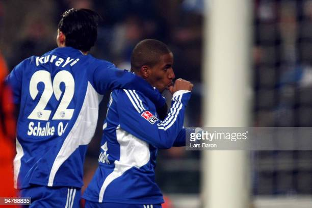 Jefferson Farfan of Schalke celebrates scoring the opening goal with team mate Kevin Kuranyi during the Bundesliga match between FC Schalke 04 and...