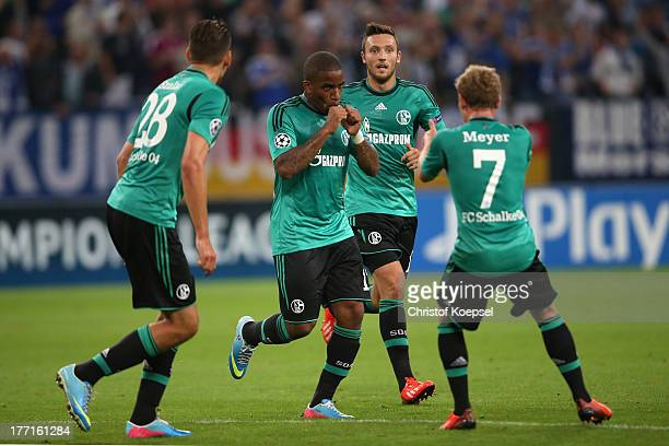 Jefferson Farfan of Schalke celebrates the first goal with Adam Szalai Marco Hoeger and Max Meyer of Schalke during the UEFA Champions League Playoff...