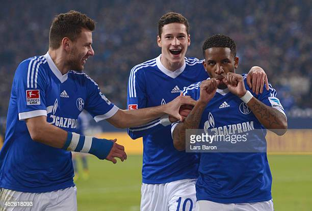 Jefferson Farfan of Schalke celebrates with Adam Szalai and Julian Draxler after scoring his teams second goal during the Bundesliga match between FC...