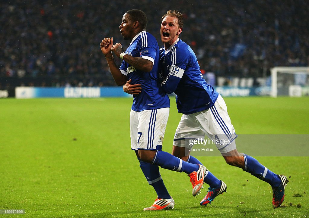 Jefferson Farfan (L)of Schalke celebrates with his team mate Benedikt Hoewedes after scoring his team's second goal during the UEFA Champions League group B match between FC Schalke 04 and Arsenal FC at Veltins-Arena on November 6, 2012 in Gelsenkirchen, Germany.