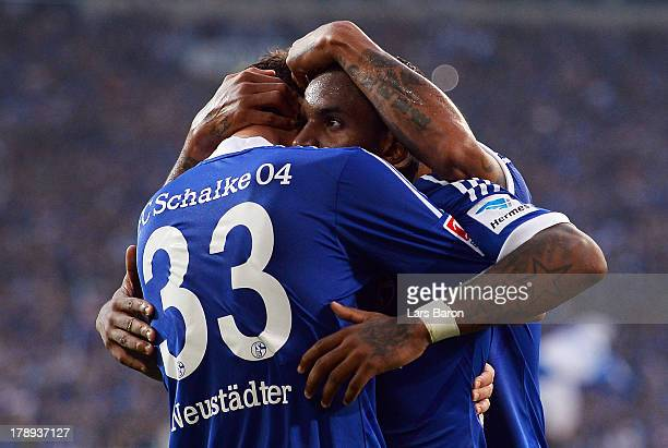 Jefferson Farfan of Schalke celebrates with team mates after scoring his teams second goal during the Bundesliga match between FC Schalke 04 and...