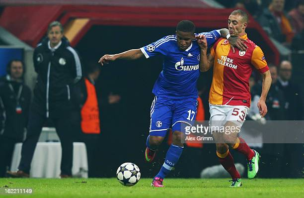 Jefferson Farfan of Schalke is challenged by Nordin Amrabat of Galatasaray during the UEFA Champions League Round of 16 first leg match between...