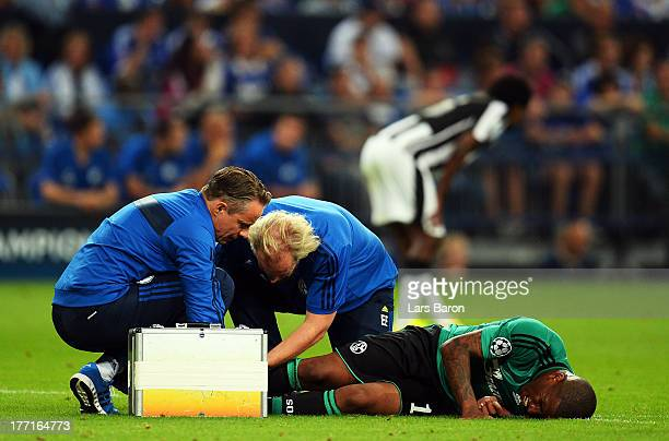 Jefferson Farfan of Schalke lies injured on the pitch during the UEFA Champions League Play-off first leg match between FC Schalke 04 and PAOK...