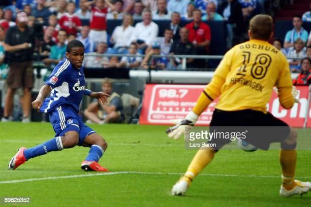 Jefferson Farfan of Schalke scores the third goal past goalkeeper Philipp Heerwagen of Bochum during the Bundesliga match between FC Schalke 04 and...