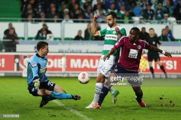 Jefferson Farfan of Schalke tries to score against goalkeeper Max Gruen anf Mergim Mavraj of Greuther Fuerth during the Bundesliga match between...