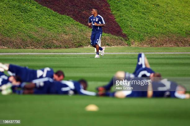 Jefferson Farfan warms up next to his team mates during a training session of Schalke 04 at the ASPIRE Academy for Sports Excellence on January 5,...