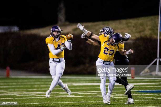 Jefferson Fritz of the University of Mary HardinBaylor intercepts a pass during the Division III Men's Football Championship held at Salem Stadium on...