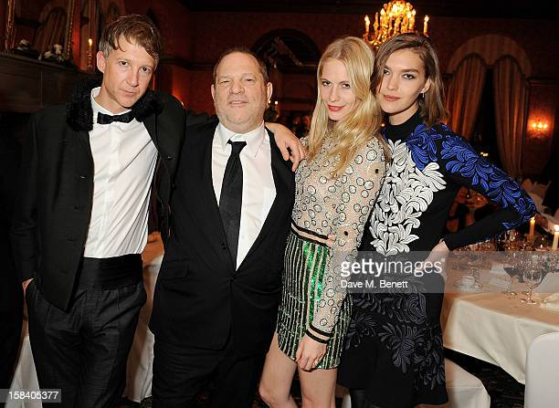 Jefferson Hack, Harvey Weinstein, Poppy Delevingne and Arizona Muse attend the ASMALLWORLD Gala Dinner for the Alzheimer's Society at The Gstaad...