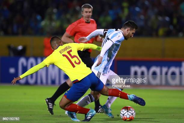 Jefferson Intriago of Ecuador struggles for the ball with Lionel Messi of Argentina during a match between Ecuador and Argentina as part of FIFA 2018...