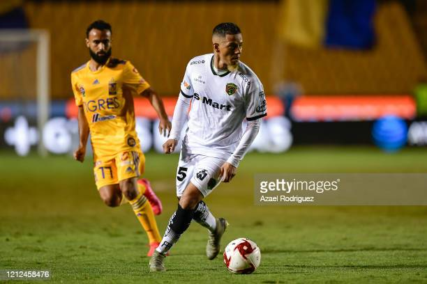 Jefferson Intriago of Juárez drives the ball against Jordan Sierra of Tigres during the 10th round match between Tigres UANL and FC Juarez as part of...