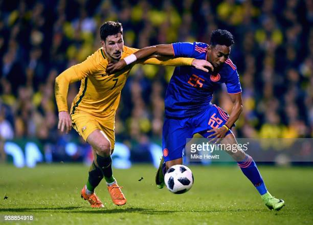 Jefferson Lemra of Columbia is challenged by Mathew Leckie of Australia during the International friendly between Australia and Colombia at Craven...