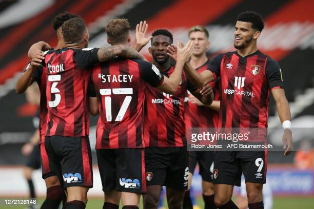 Jefferson Lerma and Dominic Solanke congratulate teammate Jack Stacey after he scores a goal to make it 10 of Bournemouth during the Sky Bet...