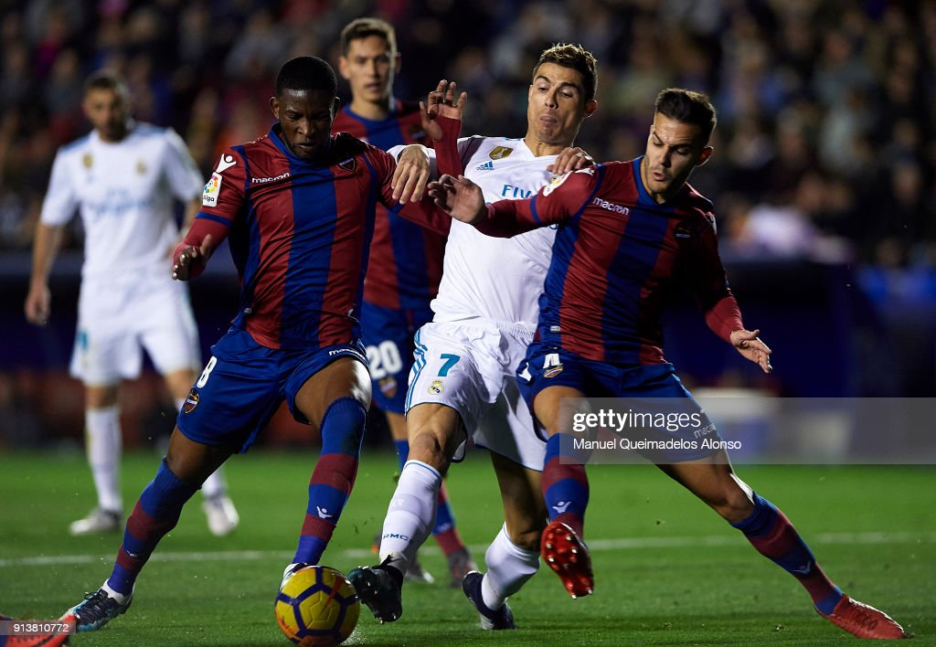 Jefferson Lerma and Rober Pier (R) of Levante compete for the ball with Cristiano Ronaldo of Real Madrid during the La Liga match between Levante and Real Madrid at Ciutat de Valencia on February 3, 2018 in Valencia, Spain.