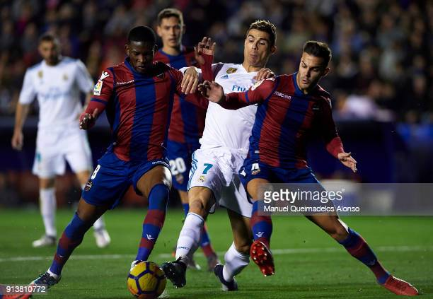 Jefferson Lerma and Rober Pier of Levante compete for the ball with Cristiano Ronaldo of Real Madrid during the La Liga match between Levante and...