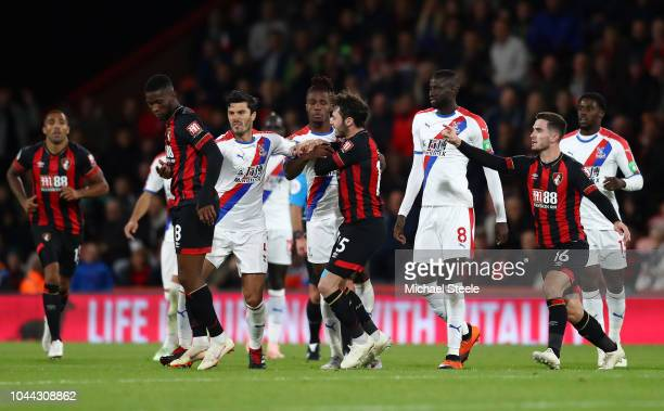 Jefferson Lerma of AFC Bournemouth and James Tomkins of Crystal Palace react during the Premier League match between AFC Bournemouth and Crystal...