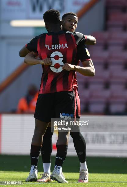 Jefferson Lerma of AFC Bournemouth celebrates with team mate Arnaut Danjuma after scoring their side's second goal during the Sky Bet Championship...