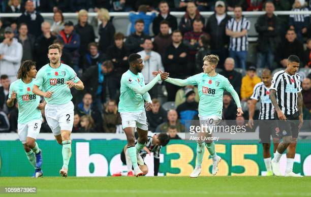 Jefferson Lerma of AFC Bournemouth celebrates with teammate David Brooks after scoring his team's first goal during the Premier League match between...