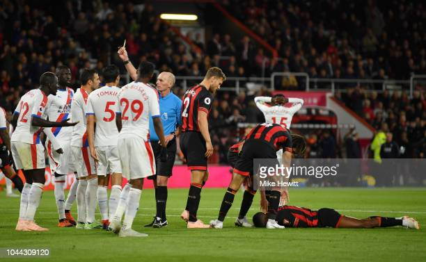 Jefferson Lerma of AFC Bournemouth lays on the floor after being fouled by Mamadou Sakho of Crystal Palace as match Referee Mike Dean awards...